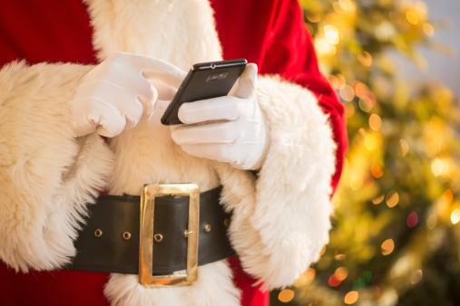 Santa claus holding cell phone
