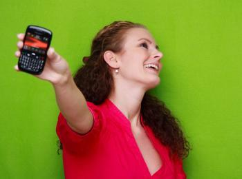 Woman showing off her BlackBerry