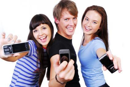Three young people with cell phones