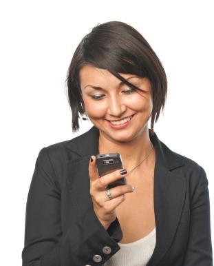 Young businesswoman using her cell phone