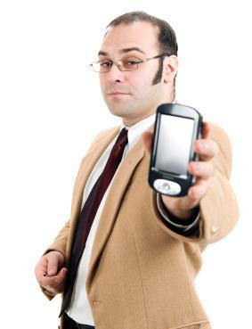 Businessman holding a PDA smartphone