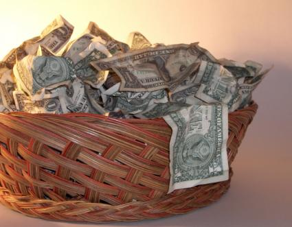 Wicker basket filled with dollar bills