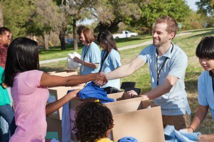Shaking a volunteer's hand