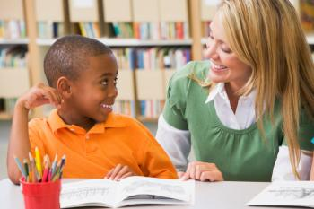 Volunteer teaching child to read
