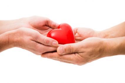 Hands holding heart