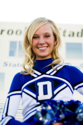 Cheerleader in blue uniform