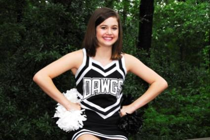 cheerleader in black and white uniform