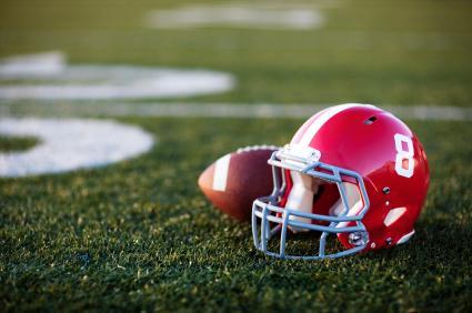 Helmet and football on the field