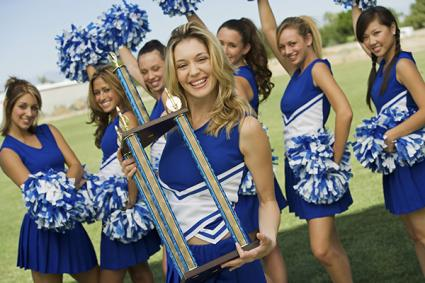 Cheerleaders with a trophy