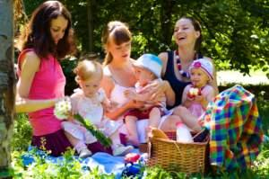 Mothers and babies at a picnic