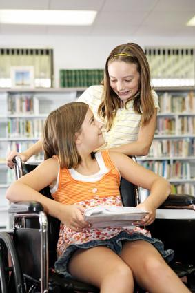 Girl in Wheelchair Reading