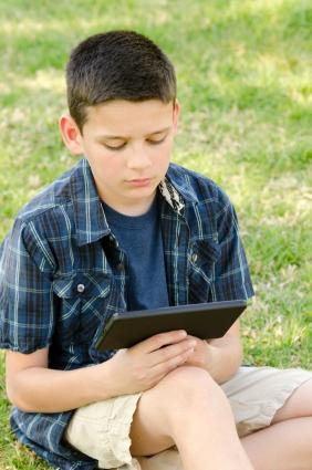 boy reading on Kindle