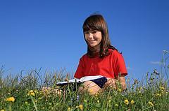 girl reading in field