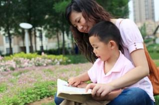 mother and son reading in spring