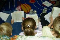 Three girls reading.