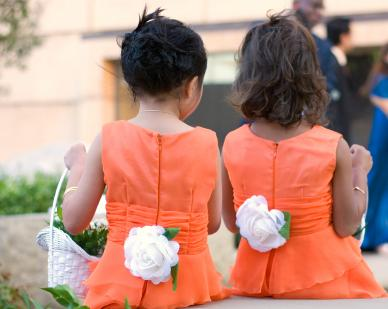 Two girls with matching orange dresses