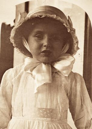 Girl wearing hat with ribbon