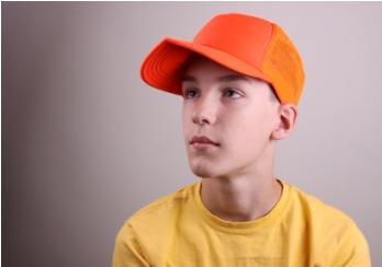 boy in bright orange cap