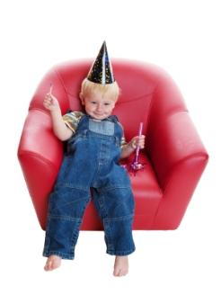 toddler boy in red chair