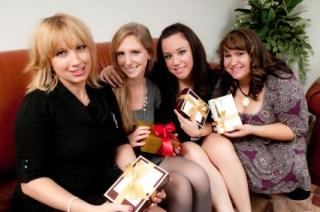 women exchanging Christmas gifts