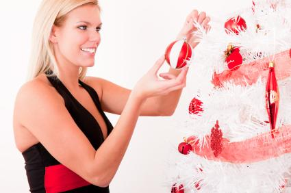 Decorating a candy cane-themed Christmas tree