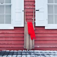 Sled propped against outside wall