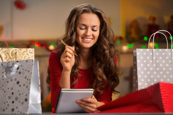 Woman checking Christmas listlist