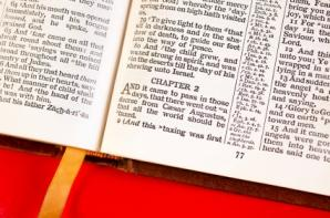 Open bible on red