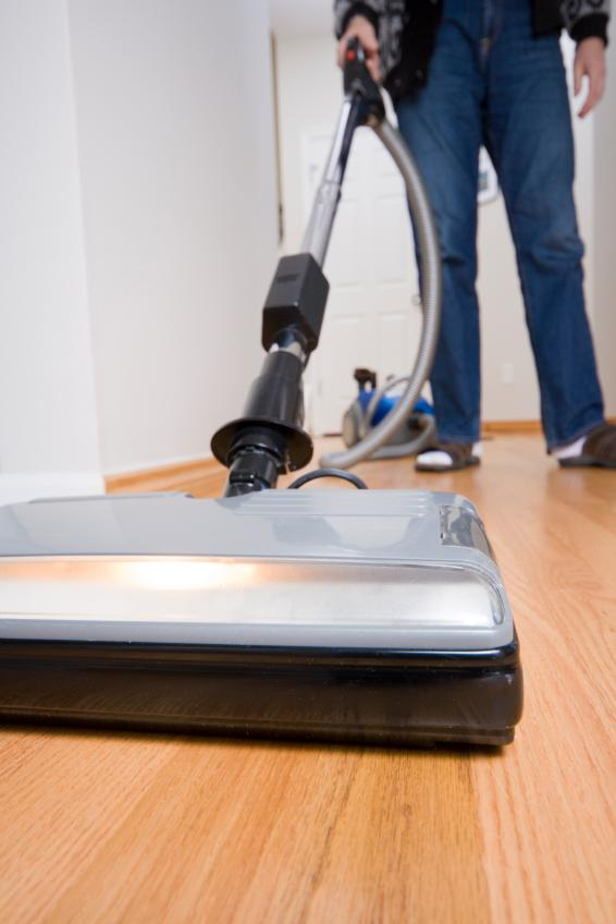 Laminate Floor Vacuum washing of laminate floor by vacuum cleaner at home stock image Cleaning Options For Laminate Floors
