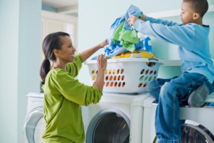 woman and child doing laundry