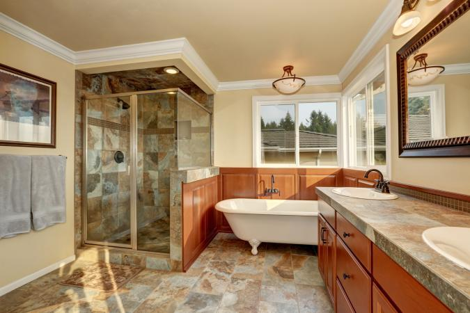 Bathroom with natural stone tile and beige walls