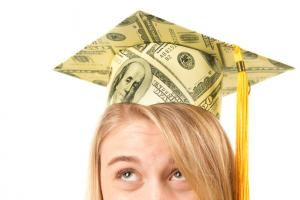 student with money mortarboard