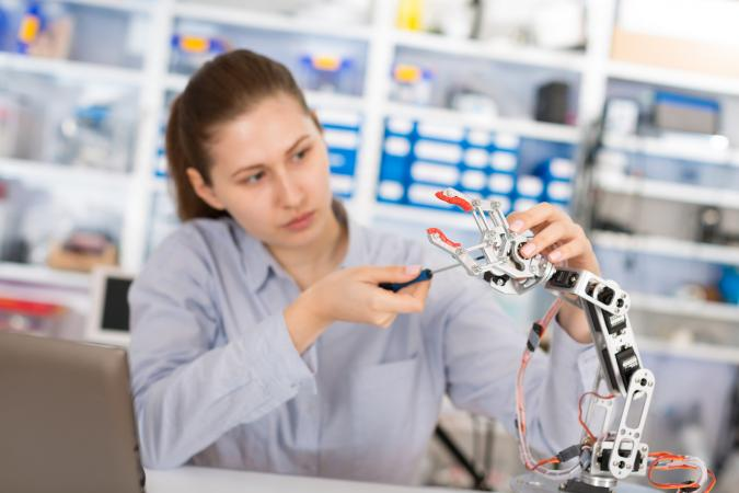 girl in robotics lab