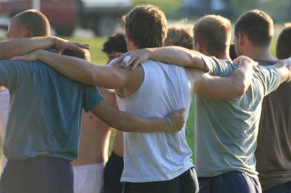 Dudes in a huddle