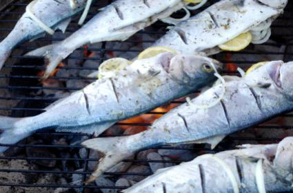 Grilling Bluefish stuffed with lemons