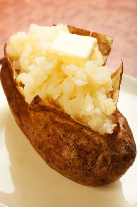 Baked potato and butter; © Msheldrake | Dreamstime.com