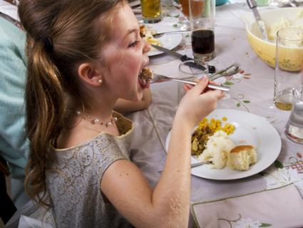 Child eating Thanksgiving dinner; © Daniel Raustadt | Dreamstime.com
