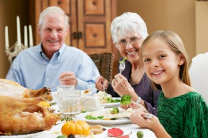 Granddaughter celebrating Thanksgiving with grandparents; © Monkey Business Images | Dreamstime.com