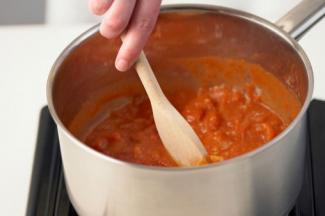 Stirring chili sauce for tamales