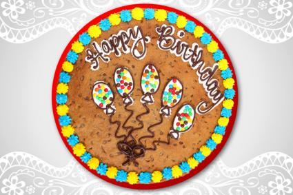 chocolate chip cookie cake on tablecloth
