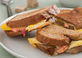 Grilled cheese, egg and bacon sandwich