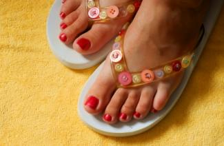 Flip flops decorated with buttons