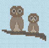 Cross-stitch owls on branch