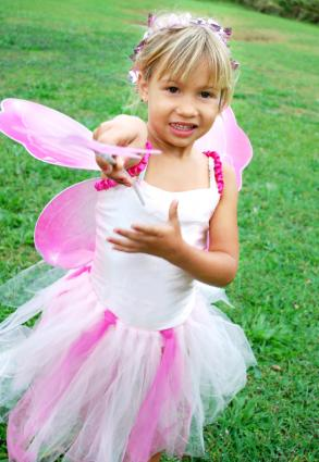 Little girl wearing a fairy costume that has a tutu