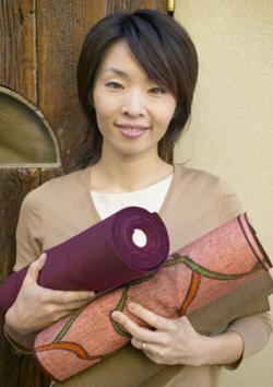 Woman holding textiles