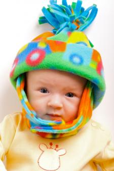 baby in fleece hat
