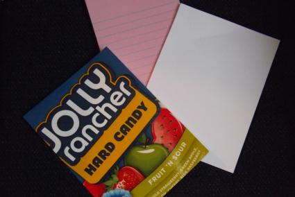 Cover card stock with candy wrapper.