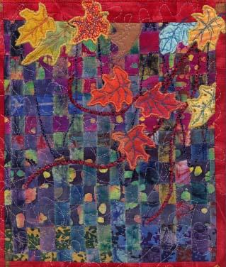 quilt with leaves and colors