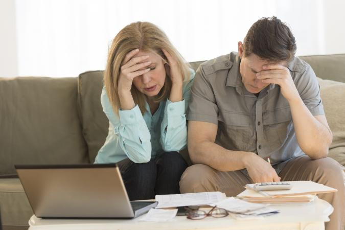 Couple calculating home finances