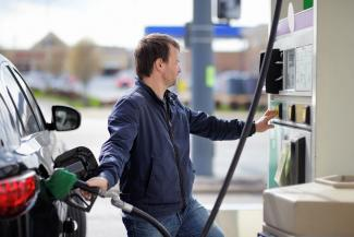 Man purchasing gas for car
